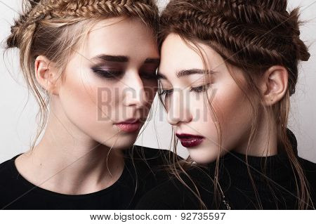 Close-up Portrait Of Couple Beauty Girls With Pigtails