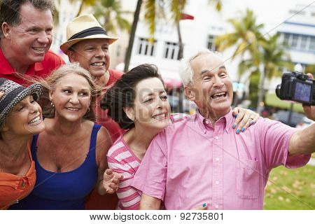 Group Of Senior Friends Taking Selfie In Park