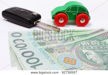 Money, Wooden Green Toy Car And Key Vehicle. White Background