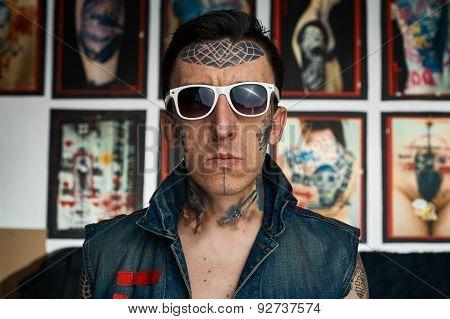 Tattoo Artist In Denim Vest And Sunglasses