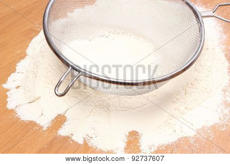 Sifting Wheat Flour Through Sieve