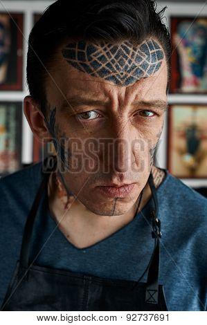 Closeup Portrait Of Tattoo Master In Studio