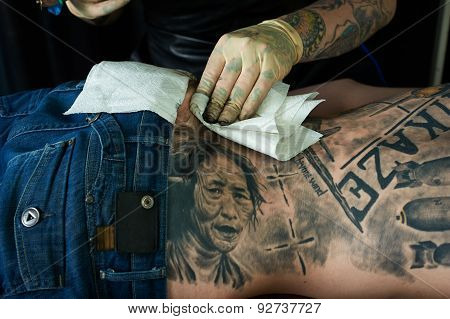 Tattoo Artist Cleaning Skin