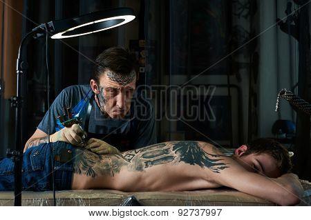 Tattooist Makes Faces