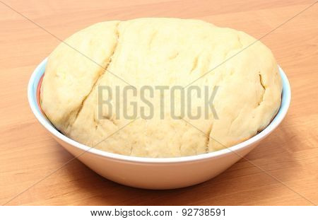 Yeast Cake In Glass Dish Lying On Wooden Table