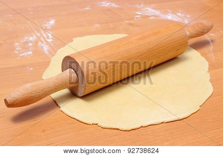 Yeast Cake And Rolling Pin On Wooden Table