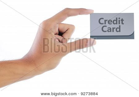 hand showing a credit card