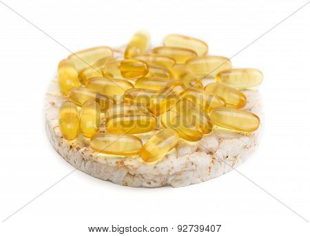 Sandwich From A Round Loaf And Omega 3 Pills.