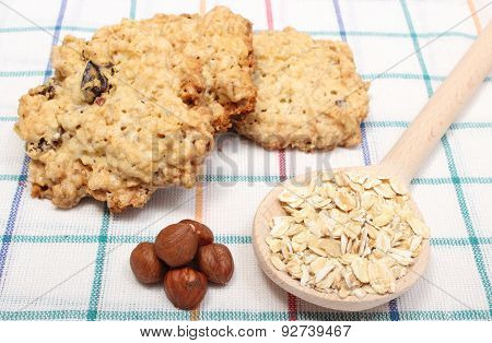 Oatmeal Cookies With Ingredients Lying On Colored Background
