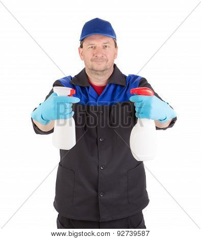 Worker holding spray bottles.