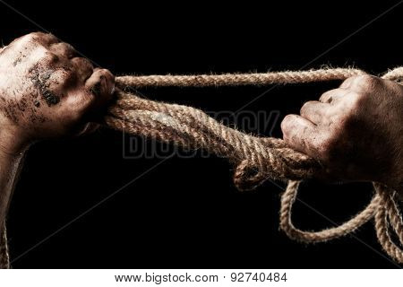 Male Hand With Rope. Conception Aggression