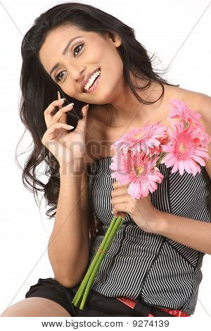 Teenage girl with cell phone and daisy  flowers