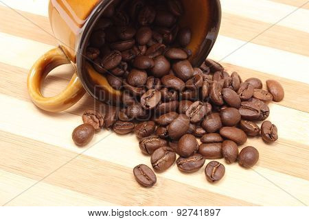 Overturned Cup And Heap Of Coffee Grains