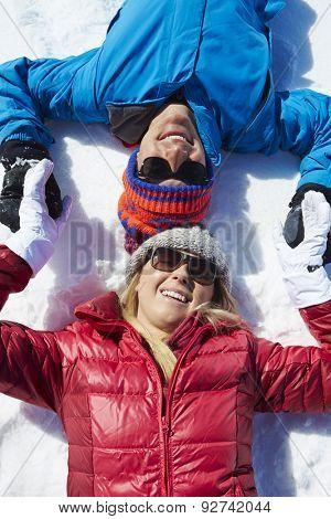 Overhead Shot Of Couple Having Fun On Winter Holiday