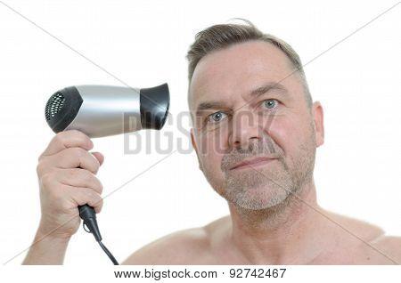 Unshaven Man Blow Drying His Short Hair