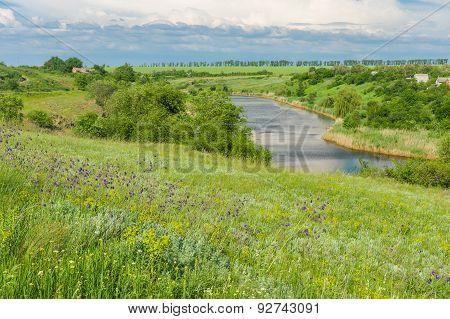 Ukrainian rural landscape with small river Sura