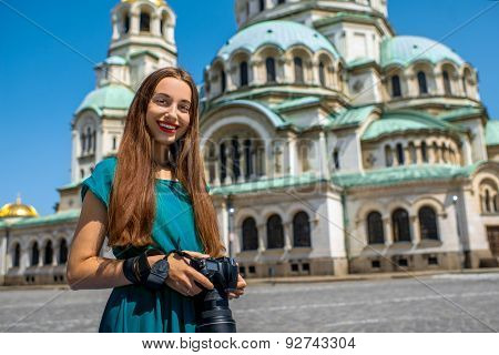 Tourist near the St. Alexander Nevsky Cathedral