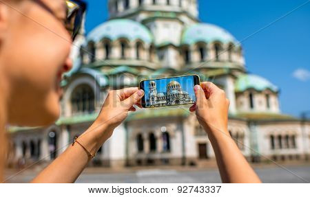 Woman photographing the St. Alexander Nevsky Cathedral