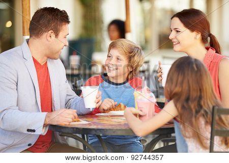 Family Enjoying Snack In Caf\x81_