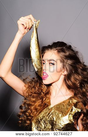 Cute Young Girl With Golden Fish