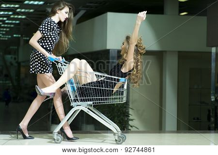 Two Alluring Girls In Shopping Trolley