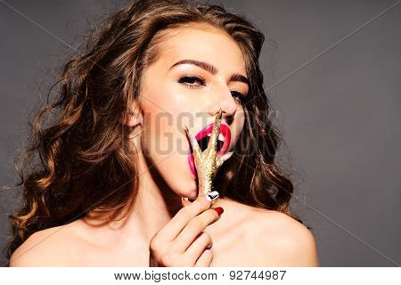 Captivating Woman With Gold Chicken Foot