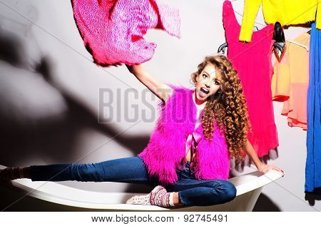 Funny Emotional Young Girl With Clothes On Bathtub