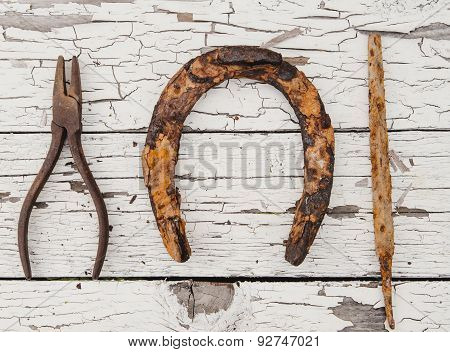 Horseshoe and tools
