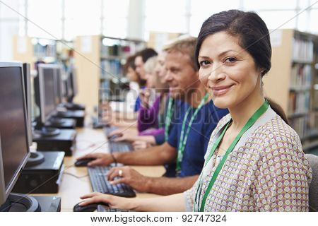Group Of Mature Students Working At Computers