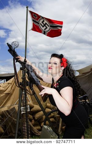 Pinup Model With Machine Gun