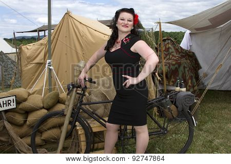 Pinup Leaning On Bicycle
