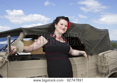 Pinup Leaning On Jeep