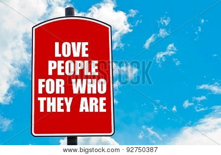 Love People For Who They Are Written On Road Sign