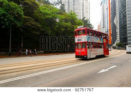 HONG KONG - JUNE 01, 2015: double-decker tram on street of HK. Hong Kong Tramways is a tram system in Hong Kong, being one of the earliest forms of public transport in the metropolis.