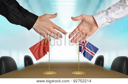 China and Iceland diplomats agreeing on a deal