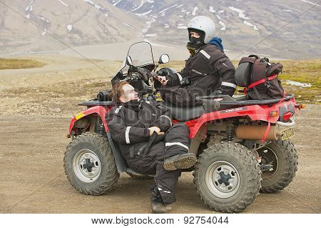People enjoy off-road vehicle excursion in Longyearbyen, Norway.