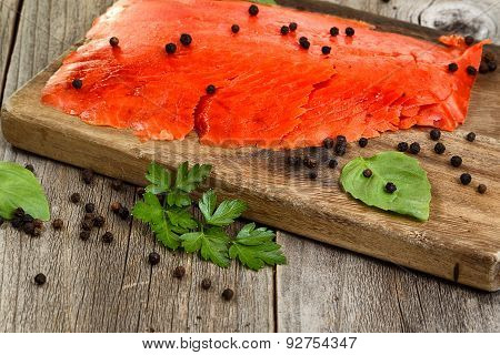Close Of Cold Smoked Salmon On Wooden Server Ready To Eat