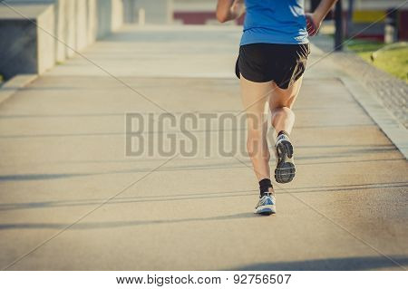 Back View Of Legs And Shoes Of Young Athletic Man Running In Summer Fitness Workout