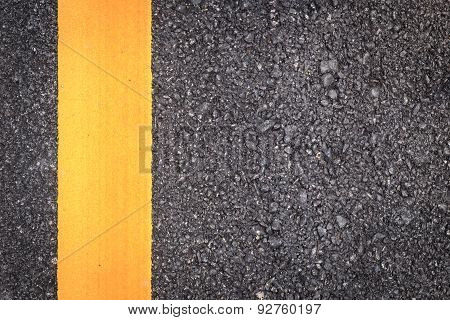 Asphalt Road Texture With Yellow Stripe