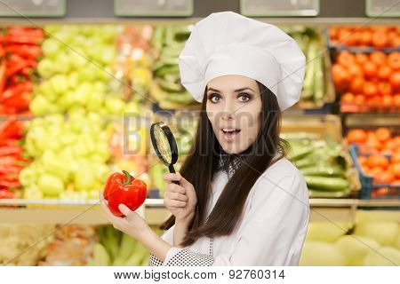 Funny Lady Chef Inspecting Vegetables with Magnifying Glass