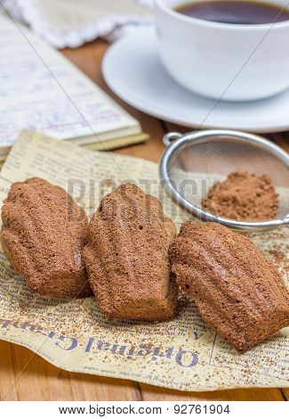 Cocoa Powdered Choco Madeleines With A Cup Of Coffee