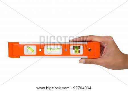 Female Hand Holding A Red Spirit Level On A White Background