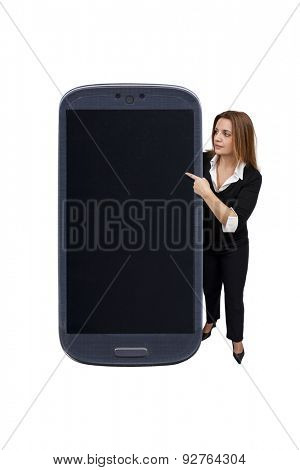 Brazilian woman pointing to a smartphone on white background.