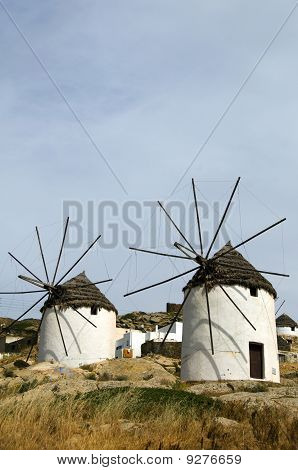 Windmill Ios Island Cyclades Greece With Thatch Roof And White Stucco Architecture