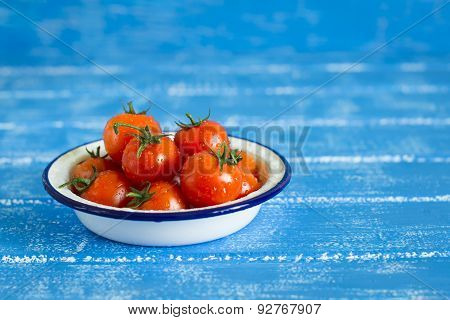 Fresh Cherry Tomatoes In A White Bowl On A Blue Wooden Background