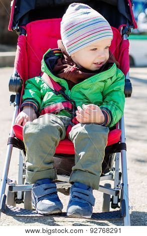 Cute Toddler In Pram On A Walk