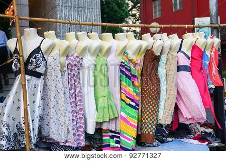 Woman dresses hanging on display at a flea market in Yangon Myanmar