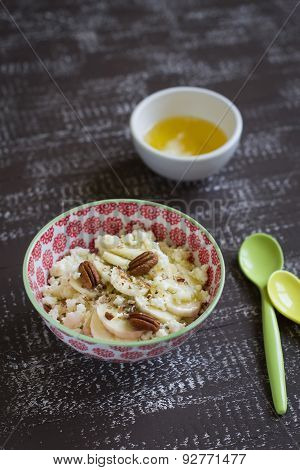 Cottage Cheese With Honey And Pecans In A Bowl On A Vintage Dark Brown Wooden Background