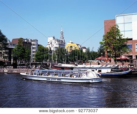 Boat on River Amstel, Holland.