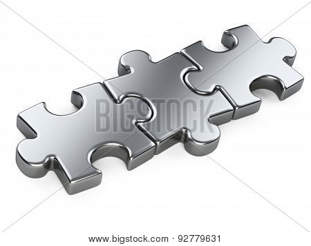 Three Metallic Puzzle Pieces.